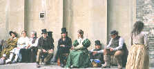 Extras relax on location during a break