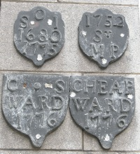 Plaques                       mark the boundaries between the mediaeval wards